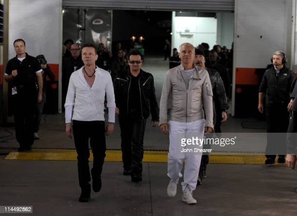 Larry Mullen Jr Bono Adam Clayton and The Edge walk on stage at the U2 360 Tour at INVESCO Field at Mile High on May 21 2011 in Denver Colorado