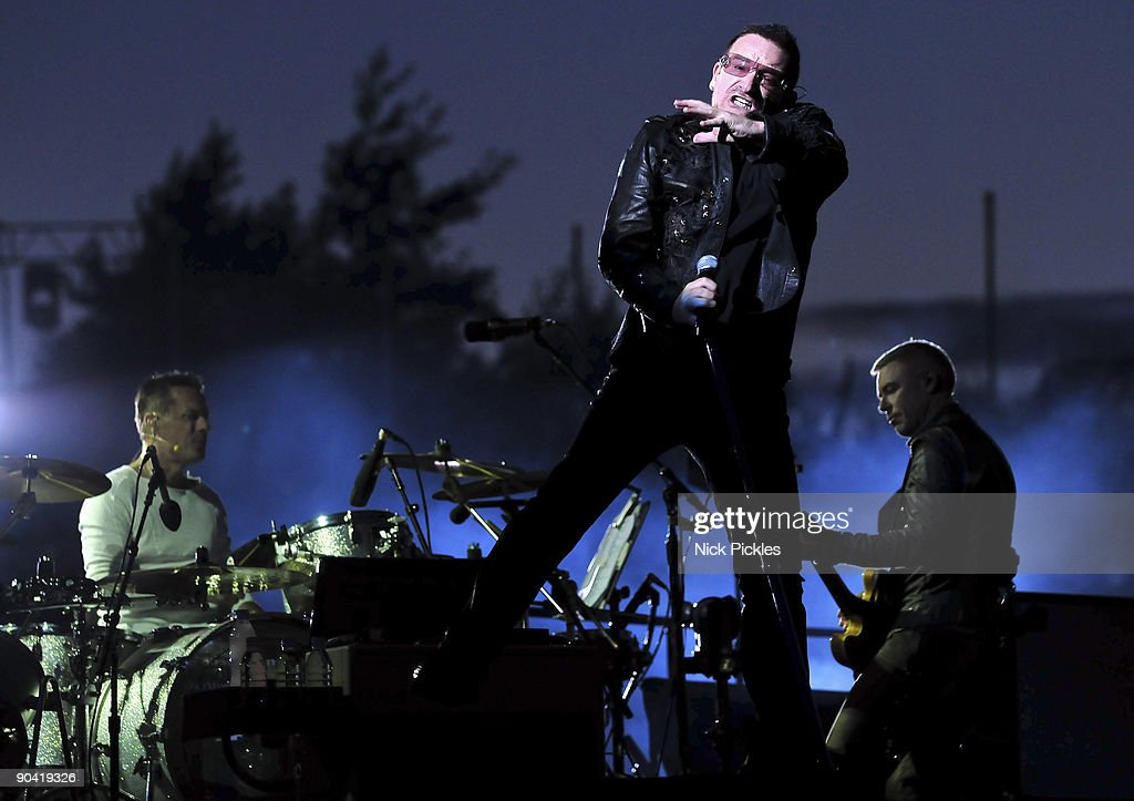 Larry Mullen, Jr., Bono (C) and Adam Clayton (R) of U2 perform at Don Valley Stadium on August 20, 2009 in Sheffield, England.
