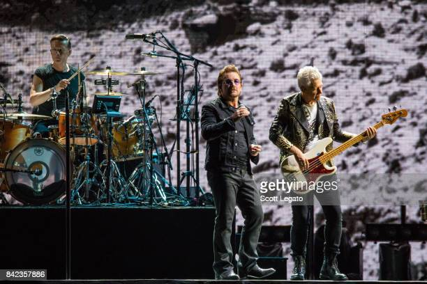 Larry Mullen Jr Bono and Adam Clayton of U2 perform during 'The Joshua Tree Tour 2017' at Ford Field on September 3 2017 in Detroit Michigan