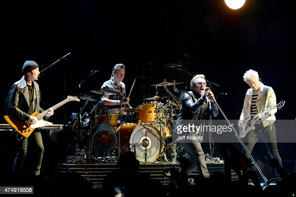 Larry Mullen Jr The Edge Adam Clayton and Bono of U2 performs at The Forum May 27 2015 in Inglewood California