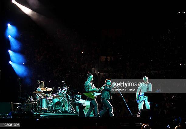 Larry Mullen Jr The Edge Bono and Adam Clayton of U2 performs on stage during the U2 360 Tour at the Stadio Olimpico on October 8 2010 in Rome Italy