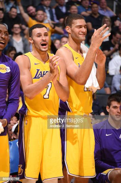 Larry Nance Jr #7 and Brook Lopez of the Los Angeles Lakers react to a play against the Utah Jazz during a preseason game on October 10 2017 at...