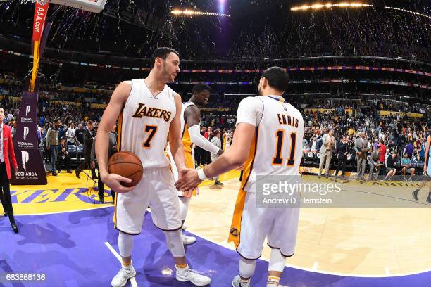 Larry Nance Jr #7 and Tyler Ennis of the Los Angeles Lakers celebrate the win against the Memphis Grizzlies on April 2 2017 at STAPLES Center in Los...