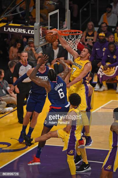 Larry Nance Jr #7 of the Los Angeles Lakers blocks the shot of DeAndre Jordan of the LA Clippers during the game on October 19 2017 at STAPLES Center...