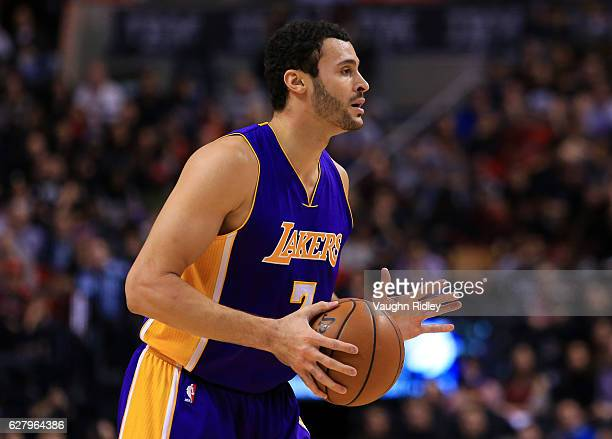 Larry Nance Jr #7 of the Los Angeles Lakers dribbles the ball during the first half of an NBA game against the Toronto Raptors at Air Canada Centre...