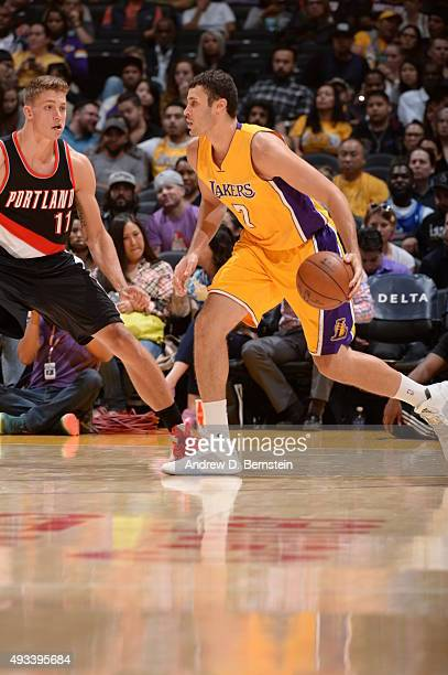 Larry Nance Jr #7 of the Los Angeles Lakers drives to the basket against the Portland Trail Blazers during the preseason game on October 19 2015 at...
