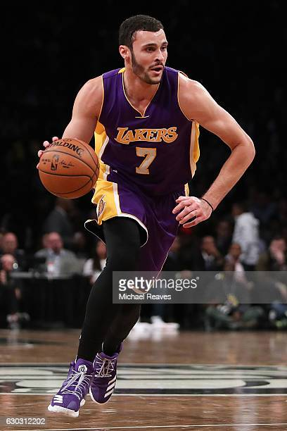 Larry Nance Jr #7 of the Los Angeles Lakers drives to the basket against the Brooklyn Nets in the second half at Barclays Center on December 14 2016...