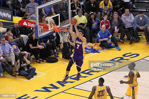 Larry Nance Jr #7 of the Los Angeles Lakers dunks against the Golden State Warriors on November 24 2015 at Oracle Arena in Oakland California NOTE TO...