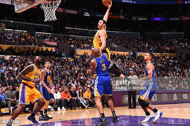 Larry Nance Jr #7 of the Los Angeles Lakers dunks against the Golden State Warriors on November 4 2016 at STAPLES Center in Los Angeles California...