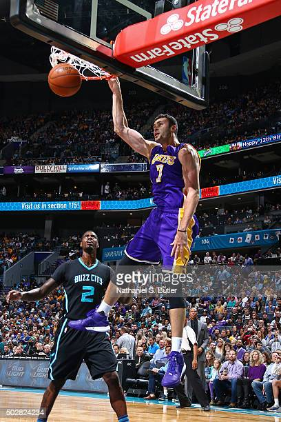 Larry Nance Jr #7 of the Los Angeles Lakers dunks the ball against the Charlotte Hornets on December 28 2015 at Time Warner Cable Arena in Charlotte...