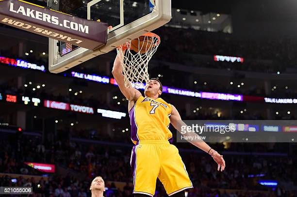 Larry Nance Jr #7 of the Los Angeles Lakers dunks the ball against the Utah Jazz in the second half at Staples Center on April 13 2016 in Los Angeles...