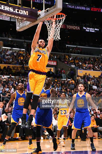 Larry Nance Jr #7 of the Los Angeles Lakers dunks the ball against the Golden State Warriors on November 4 2016 at STAPLES Center in Los Angeles...