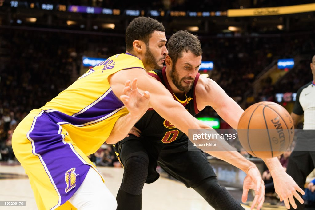 Larry Nance Jr. #7 of the Los Angeles Lakers fights with Kevin Love #0 of the Cleveland Cavaliers for a loose ball during the second half at Quicken Loans Arena on December 14, 2017 in Cleveland, Ohio. The Cavaliers defeated the Lakers 121-112.
