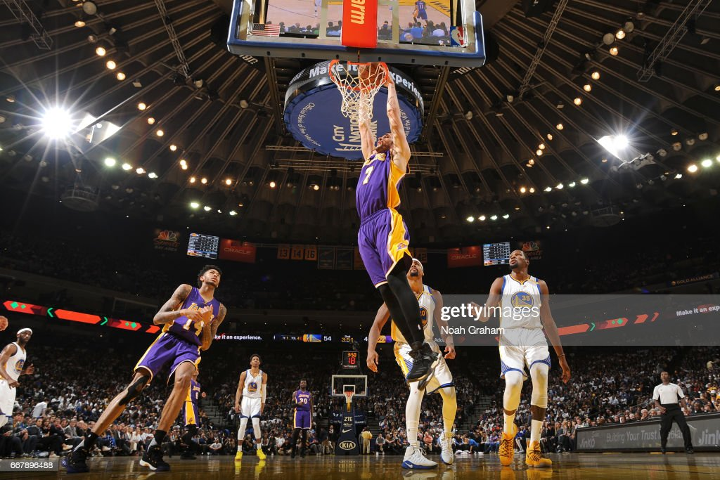Larry Nance Jr. #7 of the Los Angeles Lakers goes up for a dunk against the Golden State Warriors on April 12, 2017 at ORACLE Arena in Oakland, California.