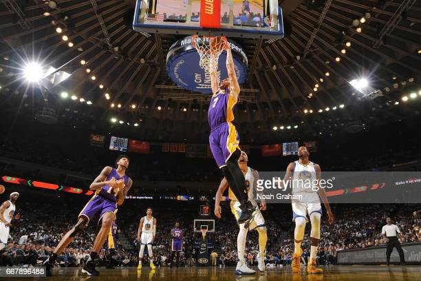 Larry Nance Jr #7 of the Los Angeles Lakers goes up for a dunk against the Golden State Warriors on April 12 2017 at ORACLE Arena in Oakland...