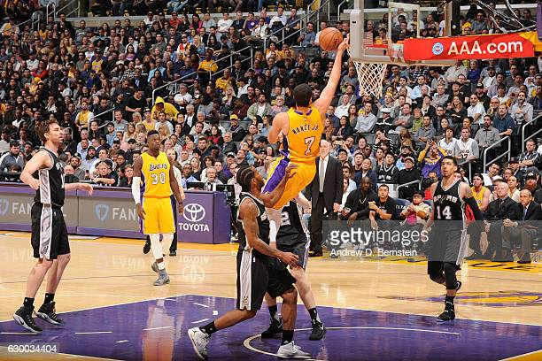 Larry Nance Jr #7 of the Los Angeles Lakers goes up for a lay up against the San Antonio Spurs on November 18 2016 at STAPLES Center in Los Angeles...