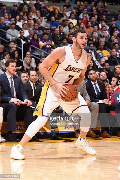 Larry Nance Jr #7 of the Los Angeles Lakers handles the ball against the New York Knicks on December 11 2016 at STAPLES Center in Los Angeles...