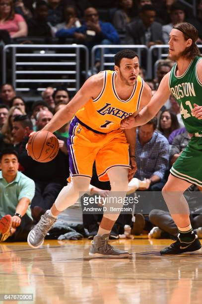 Larry Nance Jr #7 of the Los Angeles Lakers handles the ball during a game against the Boston Celtics on March 3 2017 at STAPLES Center in Los...