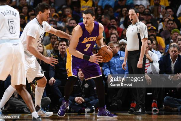 Larry Nance Jr #7 of the Los Angeles Lakers handles the ball during a game against the Denver Nuggets on March 13 2017 at the Pepsi Center in Denver...