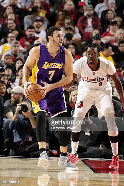 Larry Nance Jr #7 of the Los Angeles Lakers handles the ball during the game against the Portland Trail Blazers on January 25 2017 at the Moda Center...