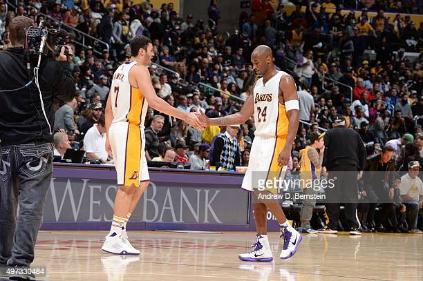 Larry Nance Jr #7 of the Los Angeles Lakers high fives Kobe Bryant of the Los Angeles Lakers during the game against the Detroit Pistons on November...