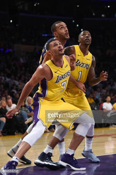 Larry Nance Jr #7 of the Los Angeles Lakers Kentavious CaldwellPope of the Los Angeles Lakers and Rudy Gobert of the Utah Jazz await the ball during...