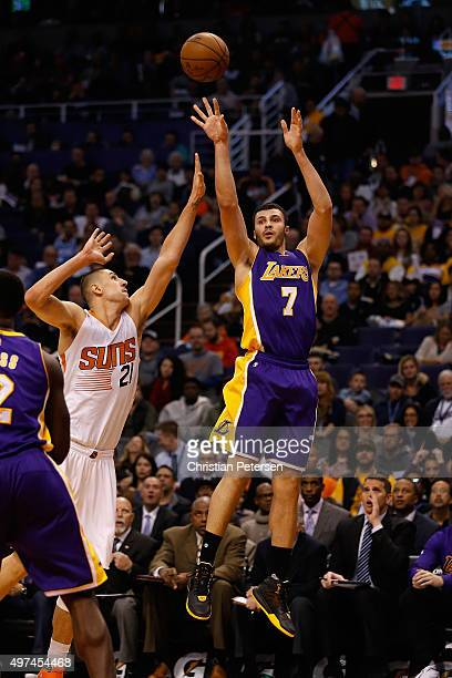 Larry Nance Jr #7 of the Los Angeles Lakers puts up a shot over Alex Len of the Phoenix Suns during the first half of the NBA game at Talking Stick...