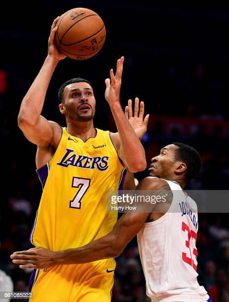 Larry Nance Jr #7 of the Los Angeles Lakers scores on his shot over Wesley Johnson of the LA Clippers during the first half at Staples Center on...