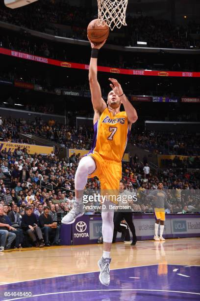 Larry Nance Jr #7 of the Los Angeles Lakers shoots a lay up against the Milwaukee Bucks on March 17 2017 at STAPLES Center in Los Angeles California...
