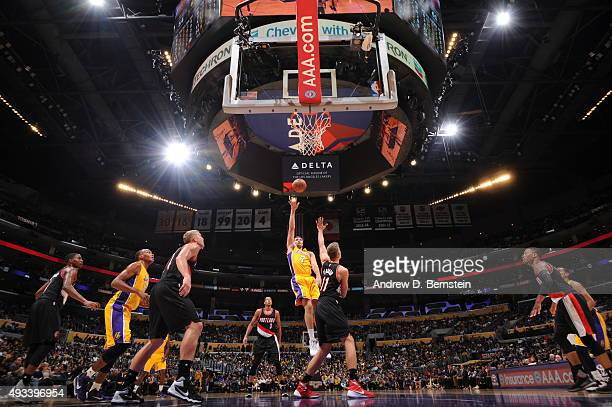 Larry Nance Jr #7 of the Los Angeles Lakers shoots against Meyers Leonard of the Portland Trail Blazers during the preseason game on October 19 2015...
