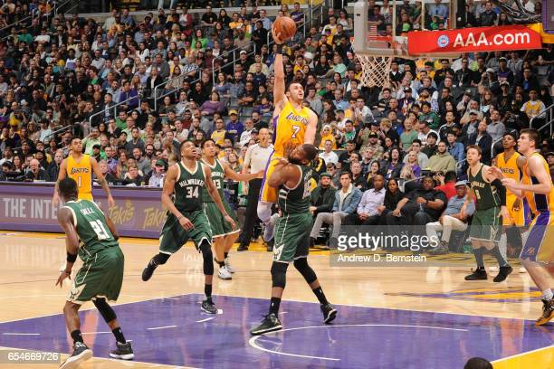 Larry Nance Jr #7 of the Los Angeles Lakers shoots the ball against the Milwaukee Bucks on March 17 2017 at STAPLES Center in Los Angeles California...