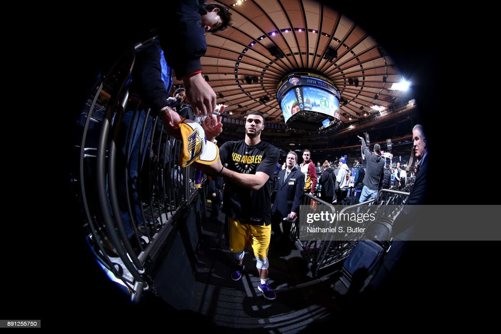 Larry Nance Jr. #7 of the Los Angeles Lakers signs an autograph for a fan prior to the game against the New York Knicks on December 12, 2017 at Madison Square Garden in New York, New York.