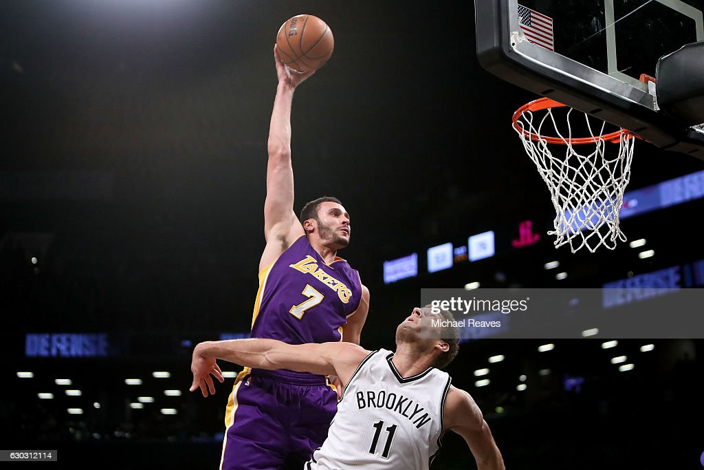 Larry Nance Jr. #7 of the Los Angeles Lakers slams home a dunk over Brook Lopez #11 of the Brooklyn Nets in the second half at Barclays Center on December 14, 2016 in the Brooklyn borough of New York City.