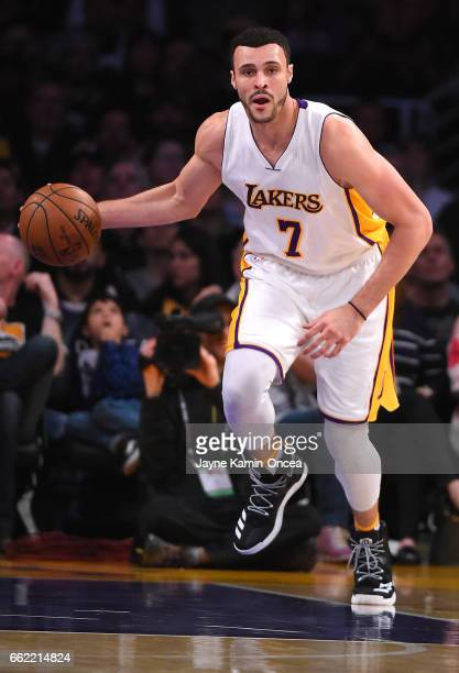 Larry Nance Jr #7 of the Los Angeles Lakers takes the ball down court during the game against the Portland Trail Blazers at Staples Center on March...
