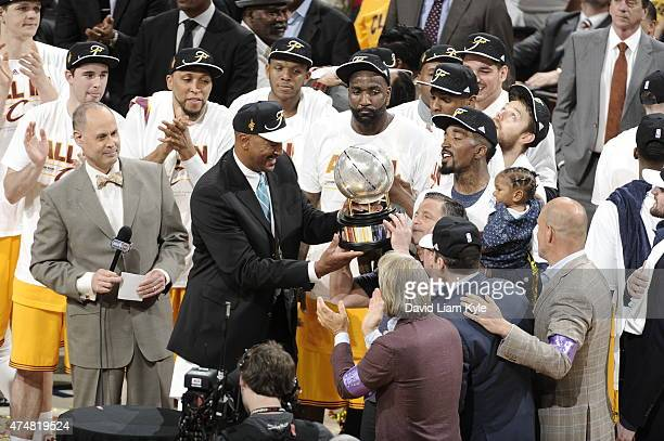 Larry Nance presents the trophy to Cleveland Cavaliers owner Dan Gilbert after the Cavaliers won the the Eastern Conference Finals in Game Four of...