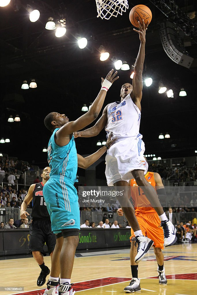 Larry Owens of the West AllStars shoots the ball over Patrick Ewing Jr #22 of the East AllStars during the 2011 NBA DLeague AllStar Game presented by...
