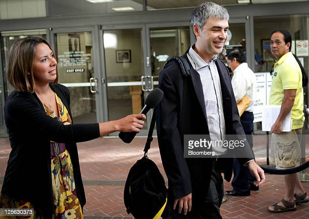 Larry Page chief executive officer of Google Inc right speaks to the media while arriving at court in San Jose California US on Monday Sept 19 2011...