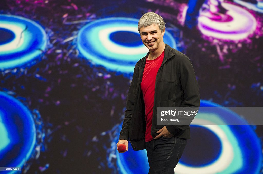 Larry Page, co-founder and chief executive officer at Google Inc., smiles while speaking at the Google I/O Annual Developers Conference in San Francisco, California, U.S., on Wednesday, May 15, 2013. Page disclosed a health condition that can result in hoarse speech and labored breathing, though according to doctors won't impede him from running the Web-search provider. Photographer: David Paul Morris/Bloomberg via Getty Images