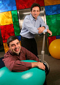 Larry Page CoFounder and President Products and Sergey Brin CoFounder and President Technology on his Segway Human Transporter pose on Google's...