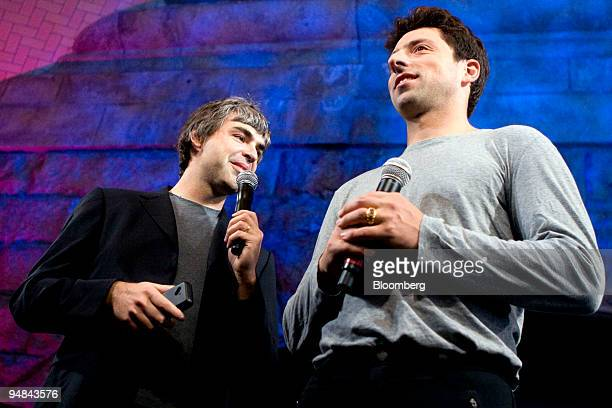 Larry Page left and Sergey Brin cofounders of Google Inc speak during the unveiling of the HTC Corp G1 mobile phone by TMobile USA Inc in New York US...
