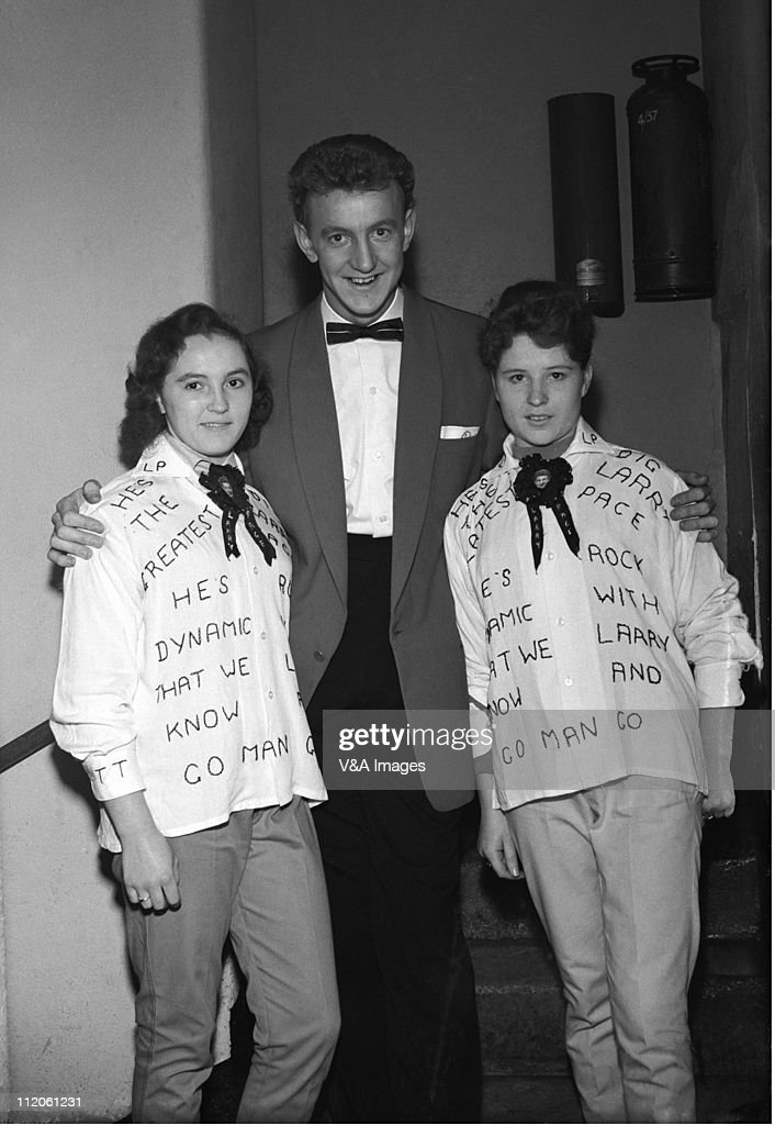 Larry Page, posed with two fans wearing customised shirts, 1956.