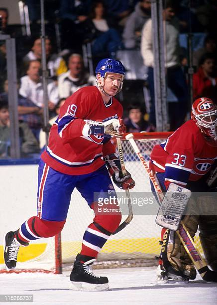 Larry Robinson of the Montreal Canadiens skates on the ice as goalie Patrick Roy looks on during an NHL game circa 1987