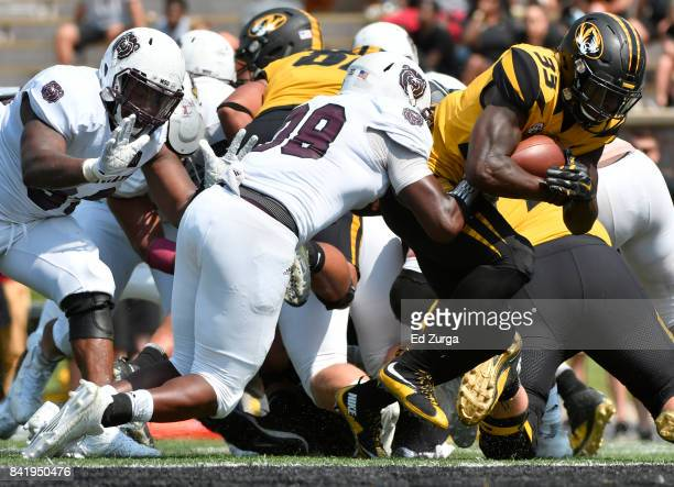 Larry Roundtree III of the Missouri Tigers goes in for a touchdown against Eric Greely of the Missouri State Bears in the fourth quarter at Memorial...