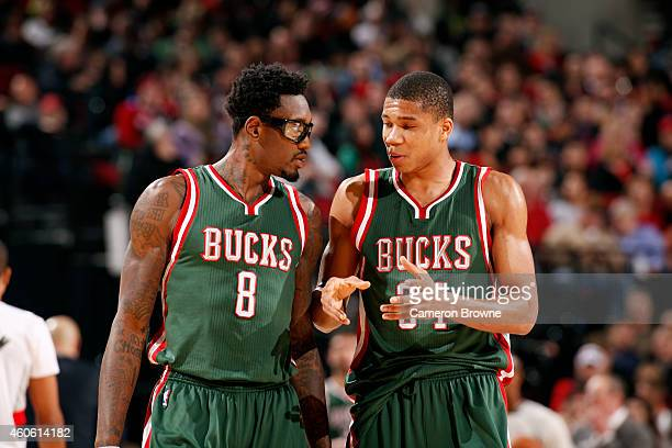 Larry Sanders and Giannis Antetokounmpo of the Milwaukee Bucks speak during a game against the Portland Trail Blazers on December 17 2014 at the Moda...
