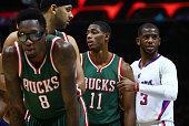 Larry Sanders Jared Dudley and Brandon Knight of the Milwaukee Bucks line up against Chris Paul of the Los Angeles Clippers prior to a Bucks in...