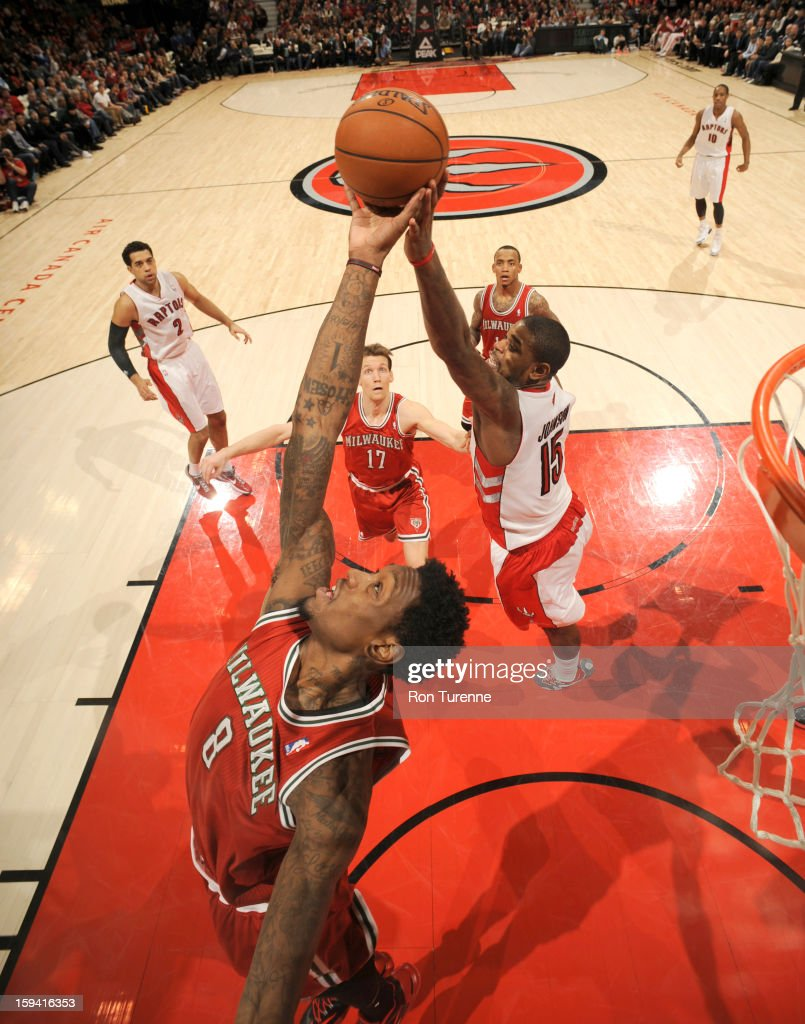 Larry Sanders #8 of the Milwaukee Bucks and <a gi-track='captionPersonalityLinkClicked' href=/galleries/search?phrase=Amir+Johnson&family=editorial&specificpeople=556786 ng-click='$event.stopPropagation()'>Amir Johnson</a> #15 of the Toronto Raptors battle for the ball control during the game between the Toronto Raptors and the Milwaukee Bucks on January 13, 2013 at the Air Canada Centre in Toronto, Ontario, Canada.