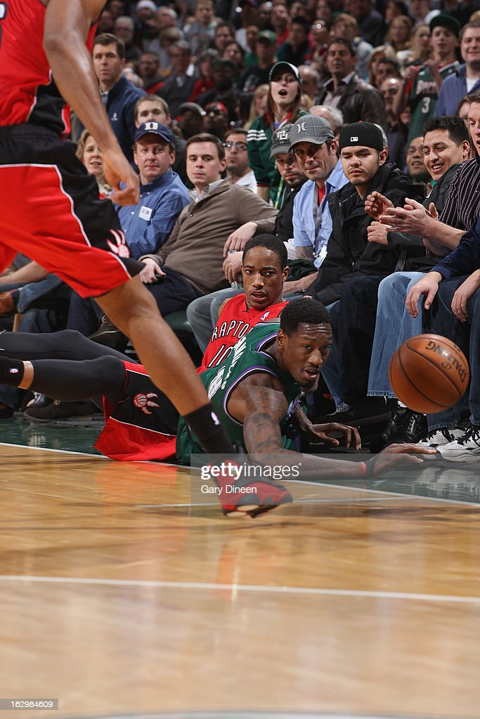 Larry Sanders #8 of the Milwaukee Bucks and DeMar DeRozan #10 of the Toronto Raptors dive for a loose ball on March 2, 2013 at the BMO Harris Bradley Center in Milwaukee, Wisconsin.