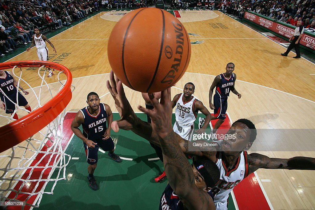 Larry Sanders #8 of the Milwaukee Bucks attempts a block against <a gi-track='captionPersonalityLinkClicked' href=/galleries/search?phrase=Josh+Smith+-+Basketball+Player+-+Born+1985&family=editorial&specificpeople=201983 ng-click='$event.stopPropagation()'>Josh Smith</a> #5 of the Atlanta Hawks during the NBA game on January 26, 2011 at the Bradley Center in Milwaukee, Wisconsin.