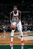 Larry Sanders of the Milwaukee Bucks attempts a free throw against the Dallas Mavericks on December 3 2014 at the BMO Harris Bradley Center in...