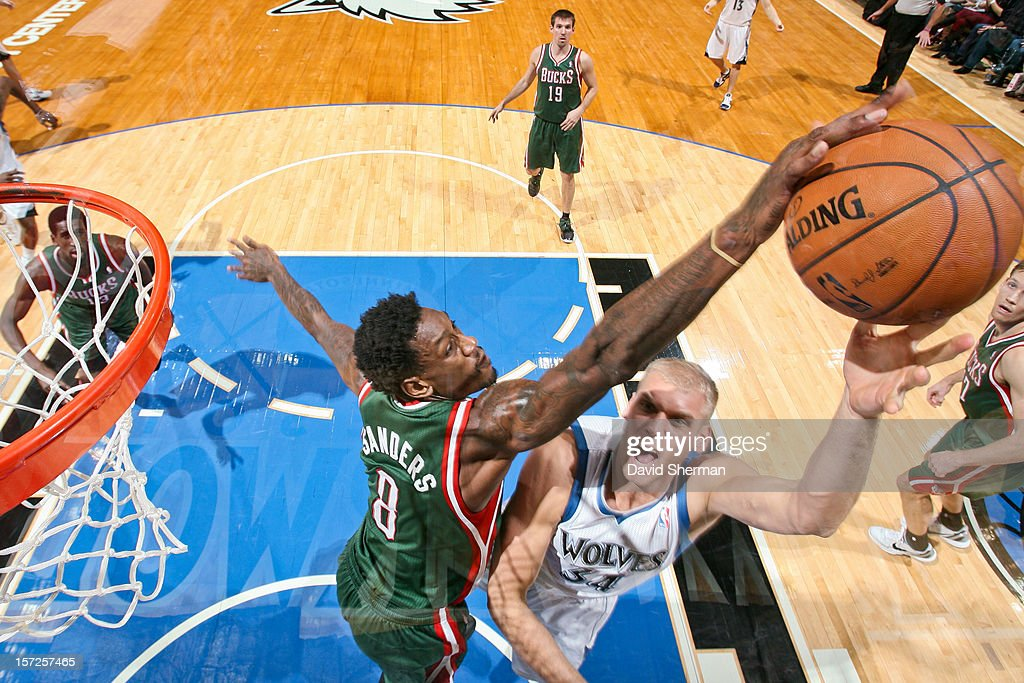 Larry Sanders #8 of the Milwaukee Bucks blocks a shot attempt by <a gi-track='captionPersonalityLinkClicked' href=/galleries/search?phrase=Greg+Stiemsma&family=editorial&specificpeople=2098297 ng-click='$event.stopPropagation()'>Greg Stiemsma</a> #34 of the Minnesota Timberwolves on November 30, 2012 at Target Center in Minneapolis, Minnesota.